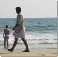 Man wearing lungi on the beach